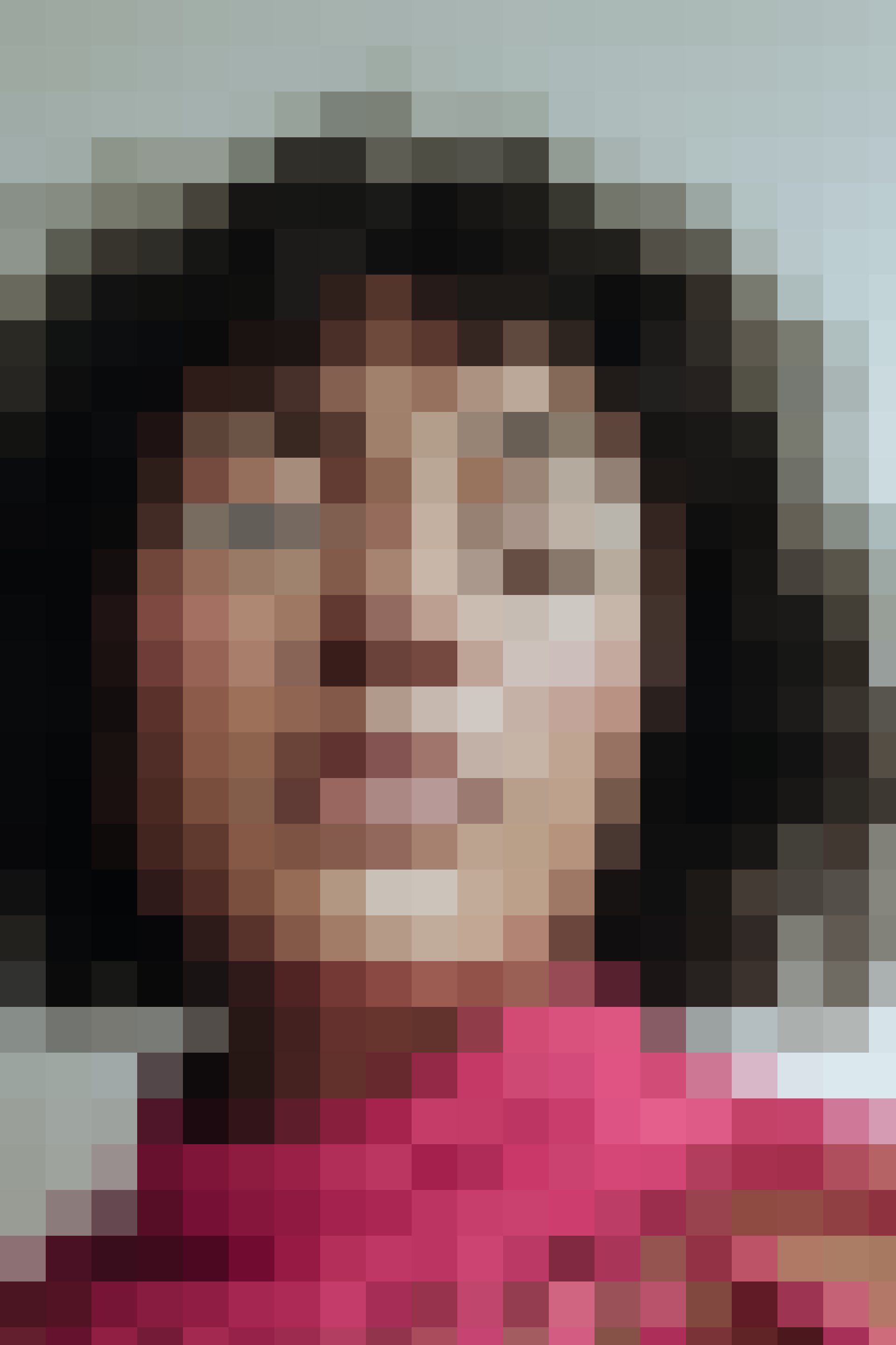 The pixelated face of a woman